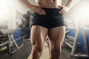 42262037 - close up of strong muscular men`s legs in the gym.