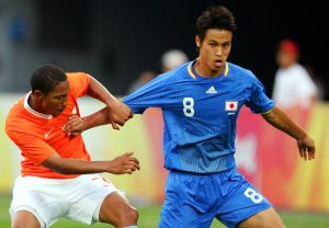 XXXXX of Netherlands and YYYY of Japan compete for the ball during Men's Group B match between Netherlands and Japan at Syenyang Olympic Stadium  on Day 5 of the Beijing 2008 Olympic Games on August 13, 2008 in Shenyang, China.