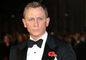 "Daniel Craig poses for photographers upon arrival for the World Premiere of ""Spectre"" at the Royal Albert Hall in central London, Monday, Oct. 26, 2015. (Photo by Joel Ryan/Invision/AP)"