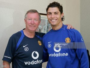 MANCHESTER, ENGLAND - NOVEMBER 18: Cristiano Ronaldo of Manchester United poses with Sir Alex Ferguson after signing a two-year contract extension that will keep him at the club until June 2010 at Carrington Training Ground on November 18 2005 in Manchester, England. (Photo by John Peters/Manchester United via Getty Images) *** Local Caption *** Cristiano Ronaldo;Alex Ferguson
