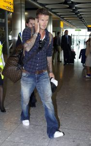 09-10-09 London, UK David Beckham flies out of Heathrow Airport to Los Angeles after Englands 5-1 against Croatia at Wembley. NON-EXCLUSIVE PIX by Flynet ©2009 818-307-4813  Nicolas